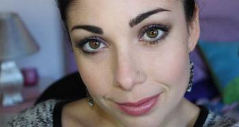 Green eye makeup with purple and brown